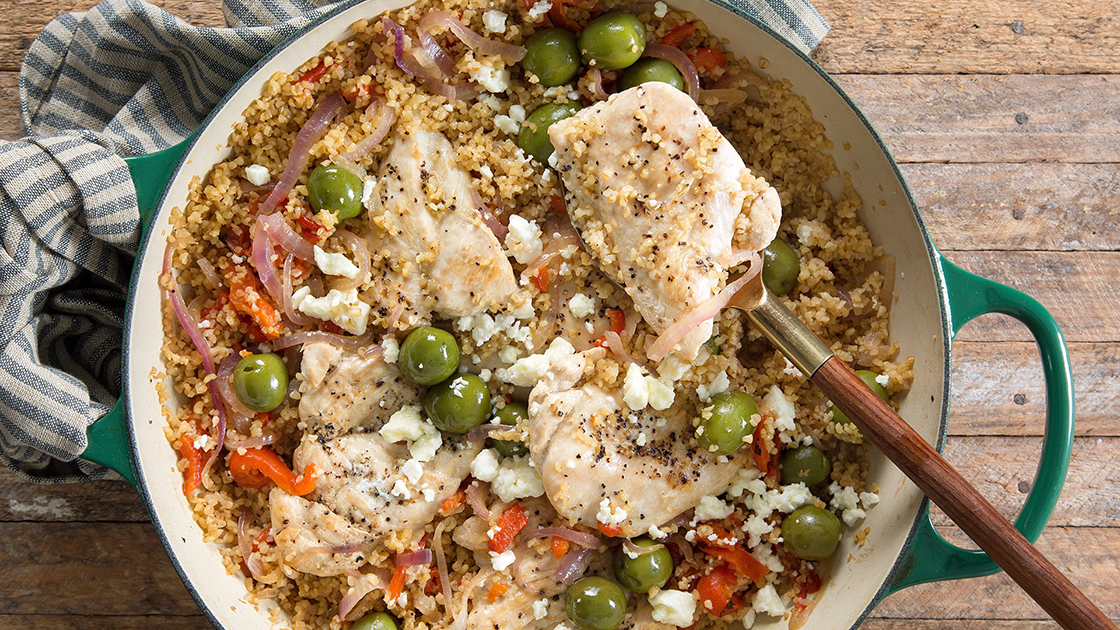 Mediterranean chicken with bulgur in a skillet