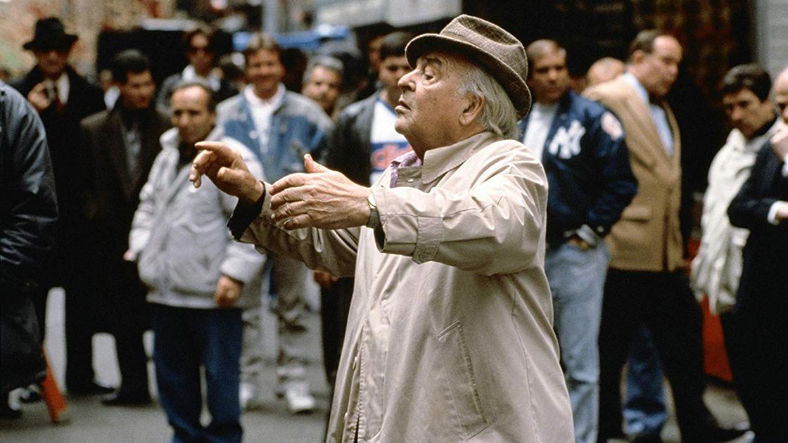 Carmine Coppola conducting on the set of a film.