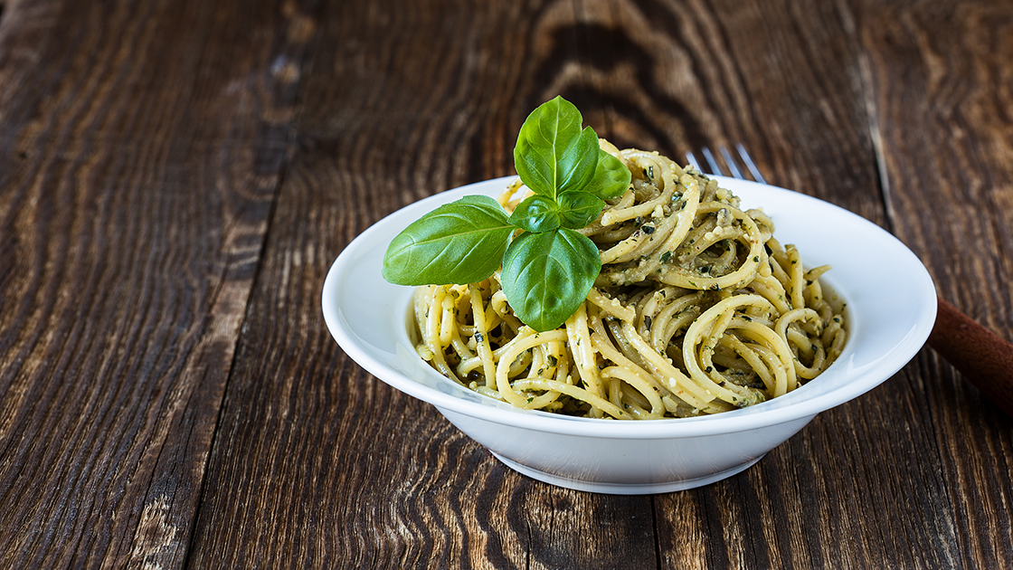 Bowl of linguine with pesto.
