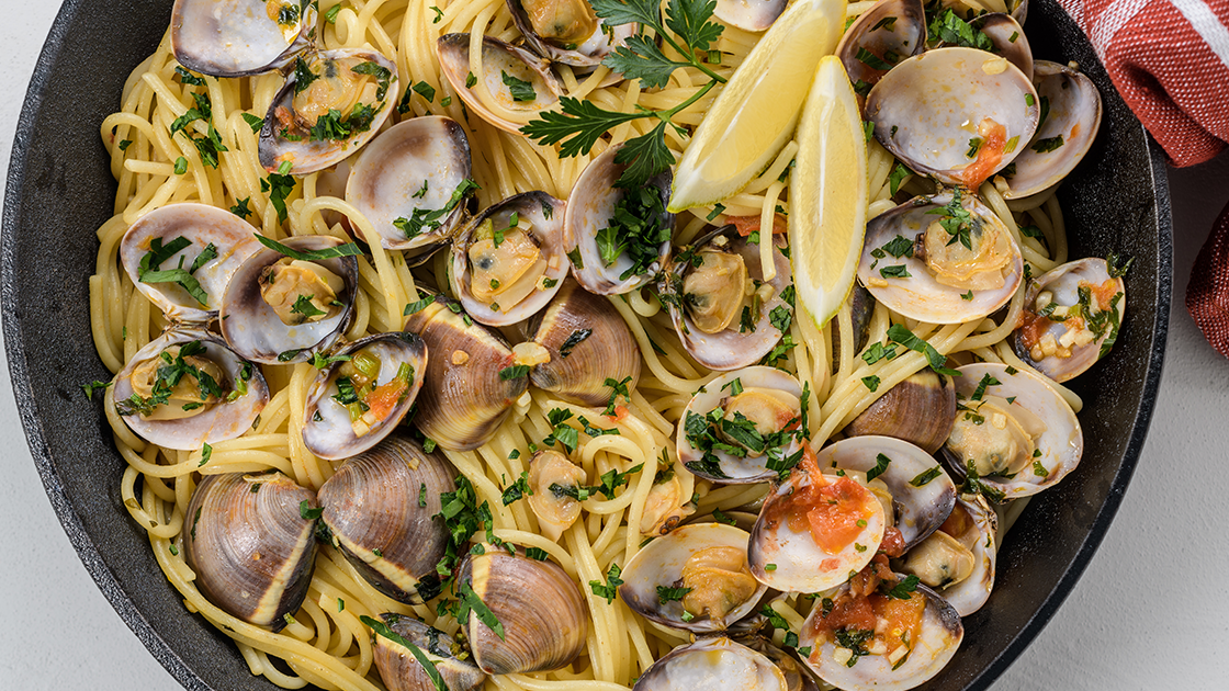 A skillet filled with Linguini with Clams Al Bianco.