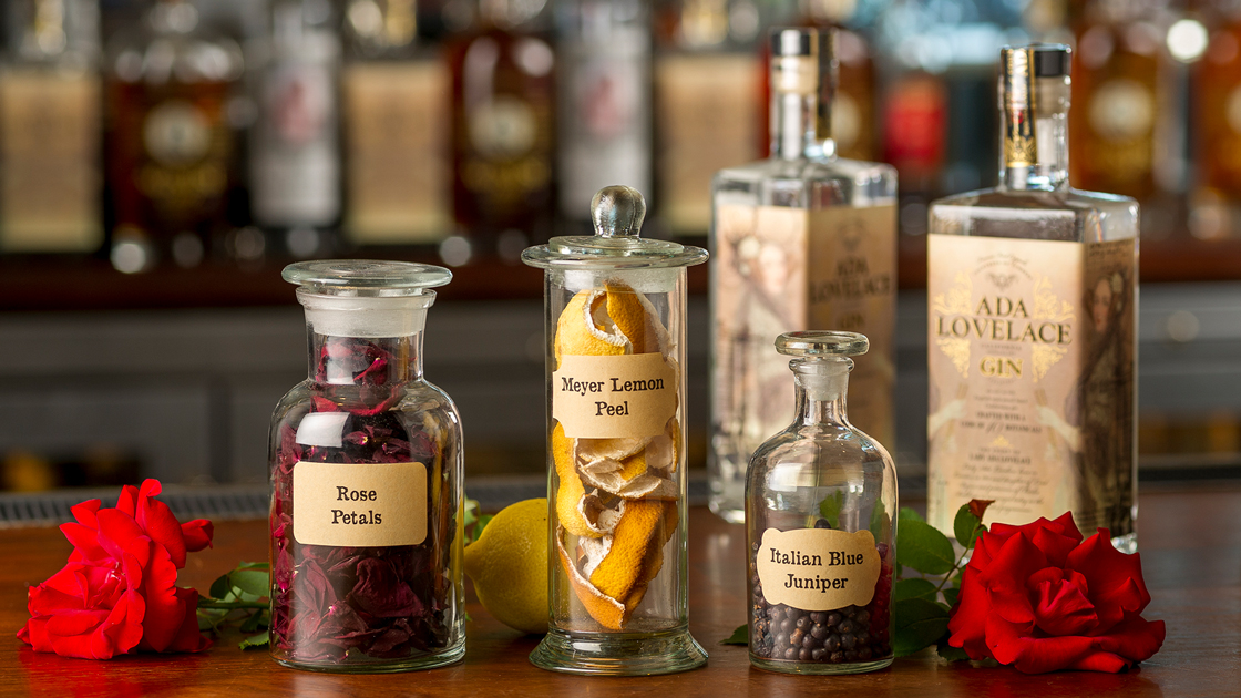 Bottles of Ada Lovelace Gin and jars of botanicals.