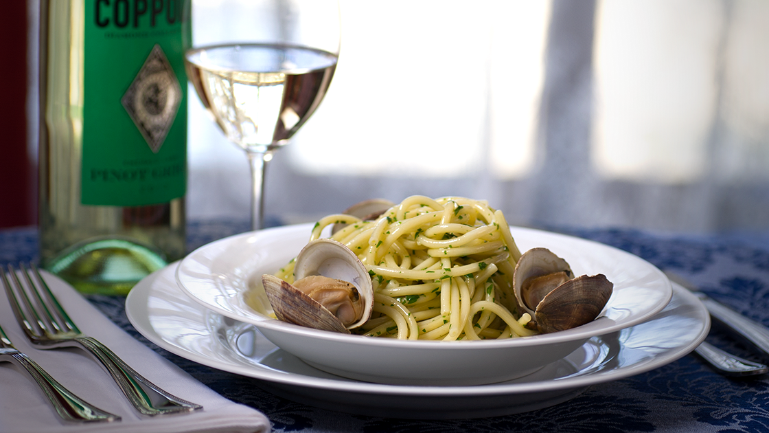 Spaghetti with Clams and a glass of pinot grigio.