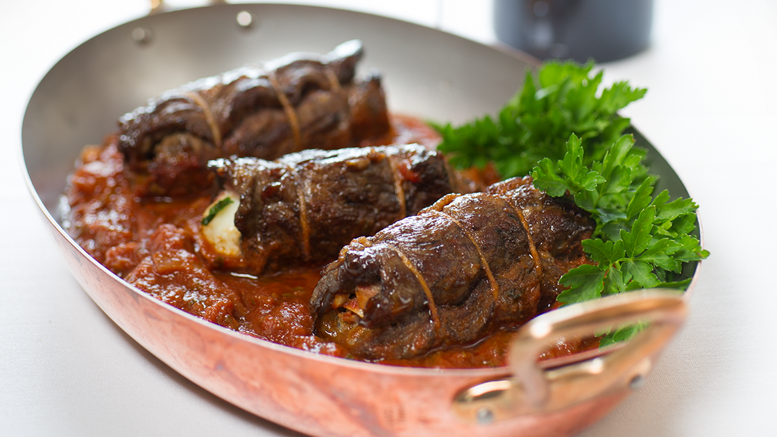 Braciole in a copper dish.