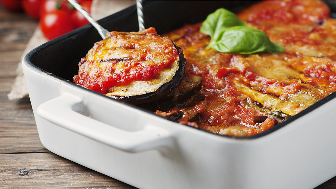 Casserole dish filled with eggplant parmigiano.