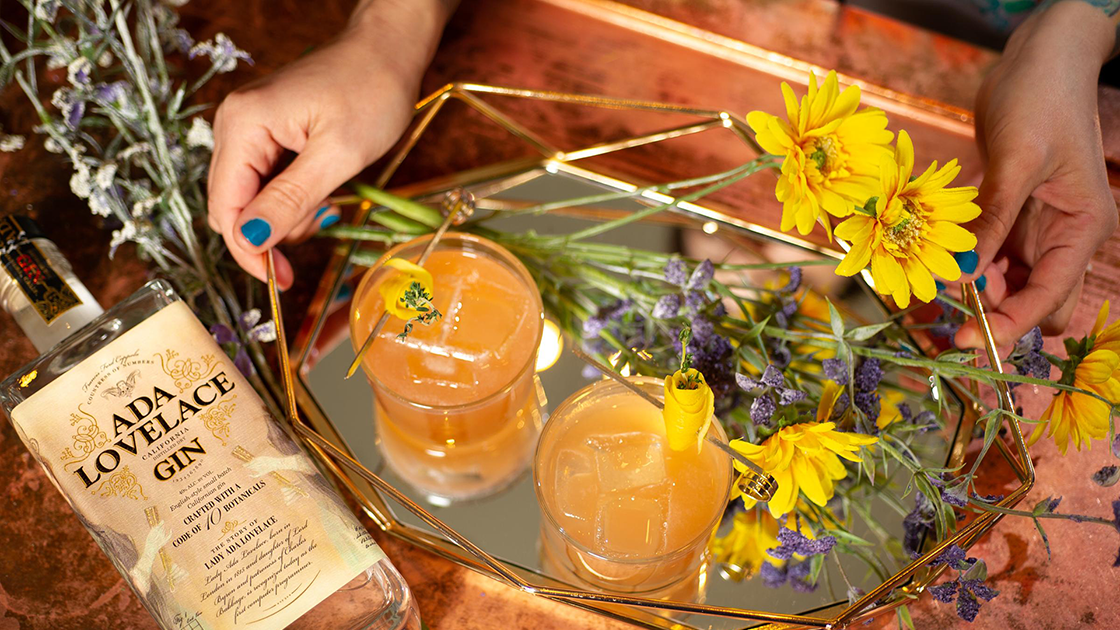 Cocktails on a tray with wildflowers.