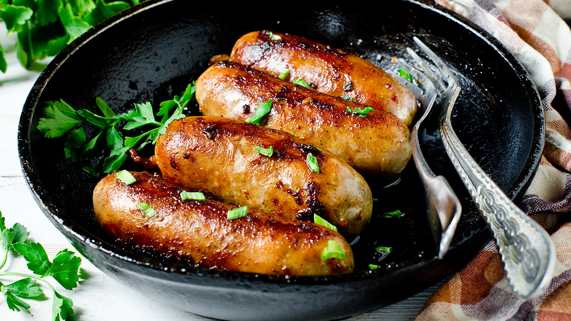 Sausages in a skillet.