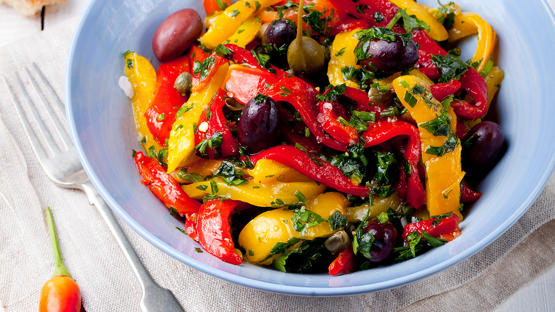Bowl of peppers and olives.