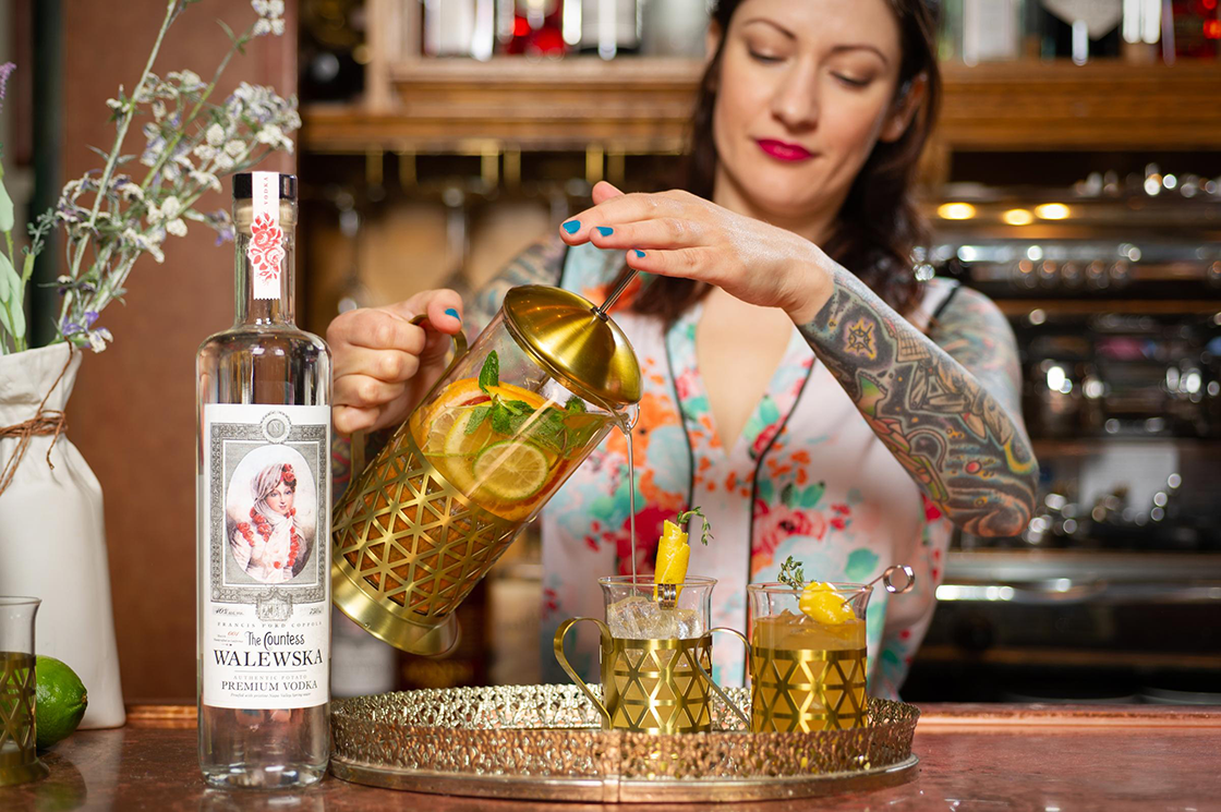 Woman pouring a cocktail.