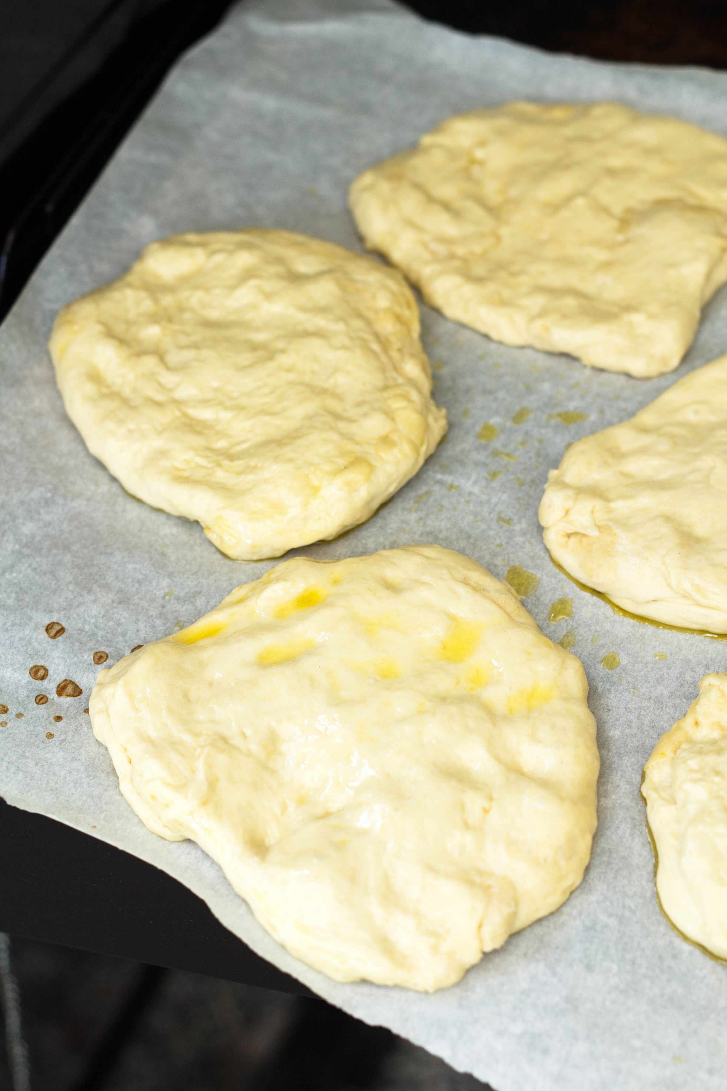 balls of flattened pizza dough
