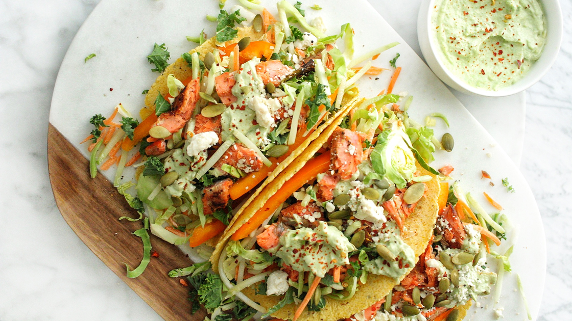 A plate of Salmon Tacos with Avocado Yogurt Crema.