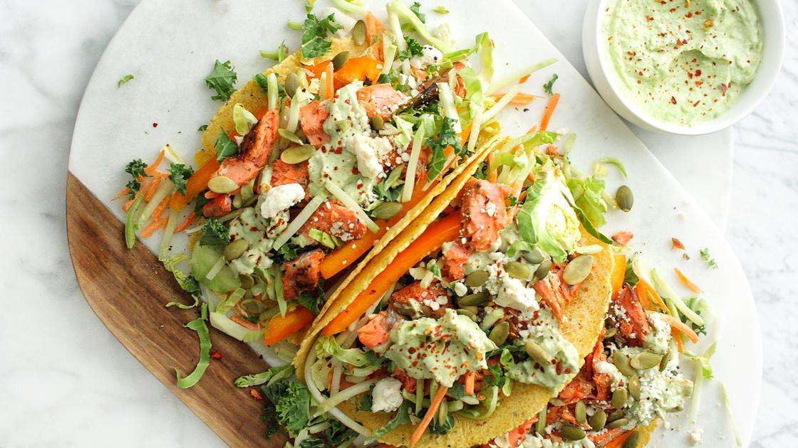 A plate of Salmon Tacos with Avocado Yogurt Crema.