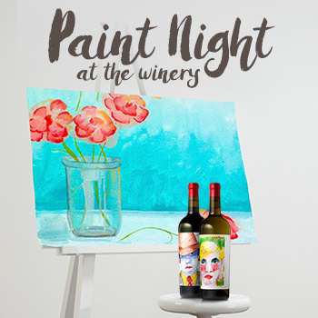 Two bottles of wine in front of a canvas on an easel with a painting of a flowers in a vase.