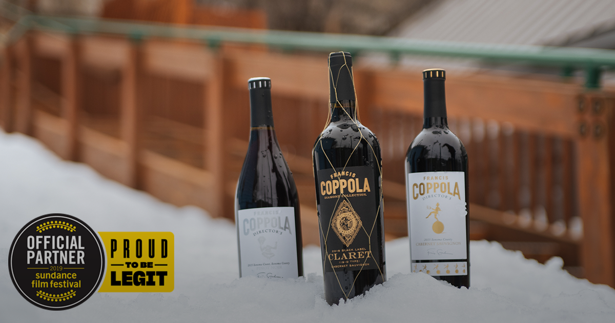 Bottles of Director's Pinot Noir, Diamond Collection Claret, and Director's Cabernet Sauvignon wine in the snow. With official partner of Sundance Film Festival badge overlay.
