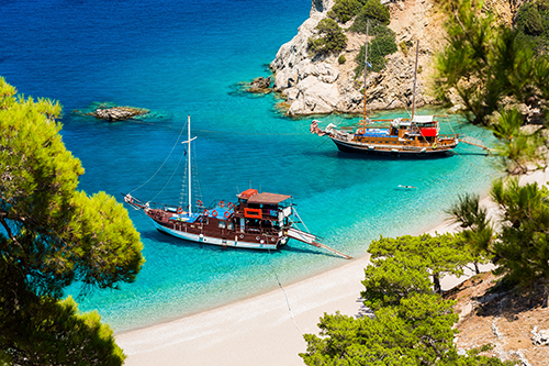 Boats on the shoreline of Karpathos, Greece.