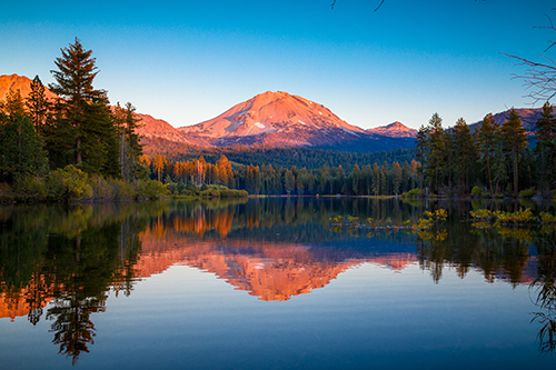 Mount Lassen reflected in a lake.
