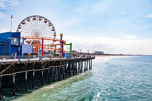 Santa Monica pier showing the ferris wheel , ocean and beach.