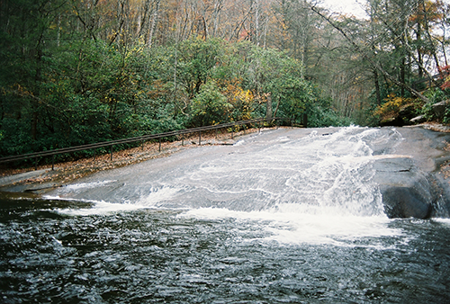 Natural well-worn 60-foot waterslide from a smooth, flattened rock.