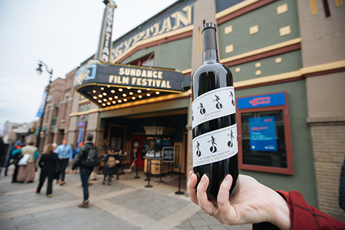 A Sundance Film Festival marquee with a bottle of Director's Cut Cabernet Sauvignon held up in front of it.
