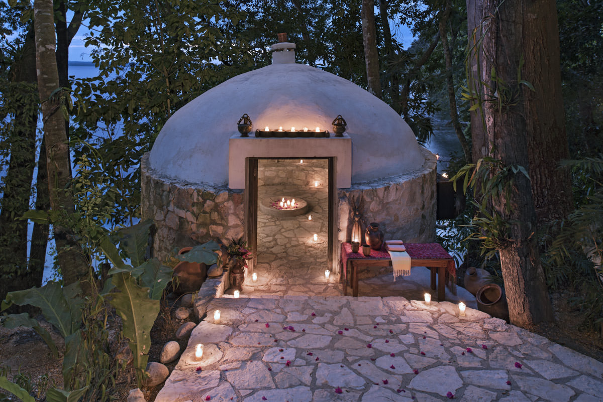 Temazcal at night with candles.